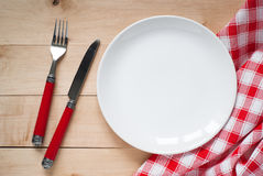 Table setting with a plate, cutlery and napkin Royalty Free Stock Photo