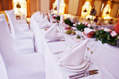 Table setting with plates and cutlery set at wedding table of ne Royalty Free Stock Images
