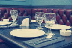 Table setting in a pub, toned image Stock Images
