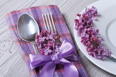 Table setting in purple colors, decoration flowers lilacs. Table setting in purple colors, decoration flowers fragrant lilacs. close-up view from above Stock Photo