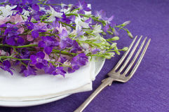 Table setting with purple flowers Royalty Free Stock Photo