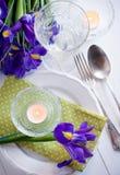 Table setting with purple iris flowers Royalty Free Stock Photos