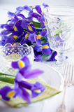 Table setting with purple iris flowers Royalty Free Stock Image