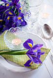 Table setting with purple iris flowers Stock Image