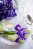Table setting with purple iris flowers Stock Image