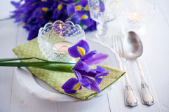 Table setting with purple iris flowers Royalty Free Stock Photo