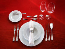 Table setting on red background. Perfect table setting on red cloth background Stock Photo