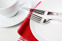 Table setting with red napkins Stock Images