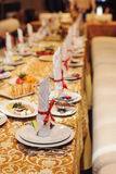 Table setting with red ribbon Stock Photo