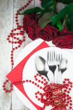 Table setting with red roses on white wood background Stock Image
