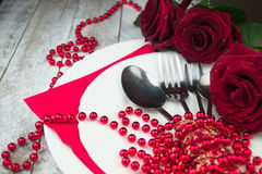 Table setting with red roses on white wood background Royalty Free Stock Photography