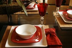 Table setting in red and white. Ceramic with Royalty Free Stock Images