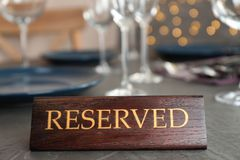 Table setting with RESERVED sign. In restaurant royalty free stock images