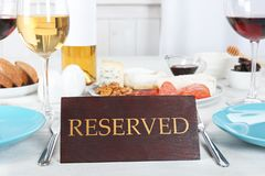 Table setting with RESERVED sign. In restaurant stock photo