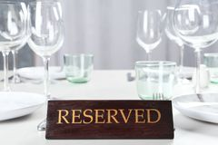 Table setting with RESERVED sign. In restaurant stock photos