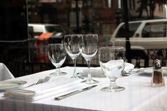 Table setting in a restaurant. A table is set and waiting for patrons Royalty Free Stock Photos