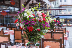 Table setting at a restaurant a bouquet of flowers Royalty Free Stock Photos