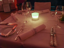 Table setting in a restaurant. With a candle Royalty Free Stock Image