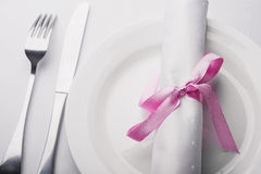 Table setting in the restaurant. Fork, knife and napkin Royalty Free Stock Image
