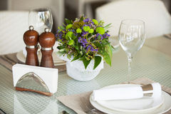 Table setting in restaurant interior, desaturated Royalty Free Stock Photos