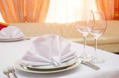 Table setting in restaurant on the sunset. Table setting for dinner or banquet in restaurant on the sunset Stock Image