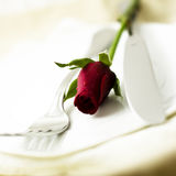 Table setting with rose. Decorative table setting with red rose Royalty Free Stock Image
