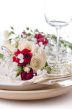 Table setting with roses in bright colors and vintage crockery Royalty Free Stock Image