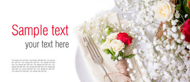 Table setting with roses in bright colors and vintage crockery, Stock Photo