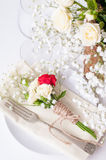 Table setting with roses in bright colors and vintage crockery Royalty Free Stock Photos
