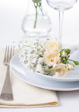 Table setting with roses in bright colors and vintage crockery Stock Images