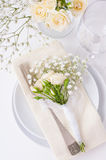 Table setting with roses in bright colors and vintage crockery Stock Photo