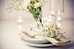 Table setting with roses in bright colors and vintage crockery Royalty Free Stock Photo