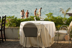 Table setting by the sea. On sunny afternoon Stock Images