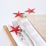Table setting with seaside theme Royalty Free Stock Photo