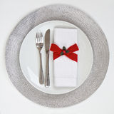 Table Setting with silver place mat Royalty Free Stock Photos