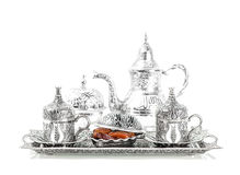 Table setting with silver tableware and dates. Oriental hospital Stock Photos