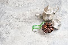 Table setting silver tableware dates Oriental hospitality concept. Table setting with silver tableware and dates. Oriental hospitality concept royalty free stock images