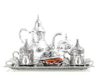 Table setting with silver tableware. Oriental hospitality. Table setting with silver tableware and dates. Oriental hospitality concept with tea or coffee cups royalty free stock images