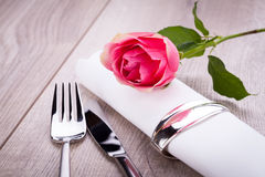 Table setting with a single pink rose Royalty Free Stock Image