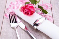 Table setting with a single pink rose Stock Photos