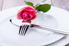 Table setting with a single pink rose Royalty Free Stock Photography
