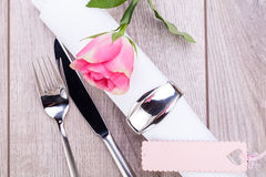 Table setting with a single pink rose Royalty Free Stock Photo