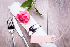 Table setting with a single pink rose Royalty Free Stock Images
