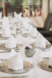 Table setting for a special dinner silver plates. Cutlery, candlesticks, white tablecloth Royalty Free Stock Image