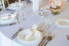 Table setting with spoon, knife, plates and glass Royalty Free Stock Images