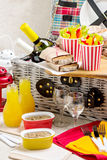 Table setting for a summer picnic. Picnic basket with food, wine Royalty Free Stock Images