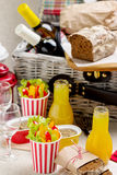 Table setting for a summer picnic. Picnic basket with food, wine Royalty Free Stock Image