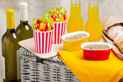 Table setting for a summer picnic. Picnic basket with food, wine Stock Image