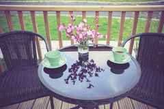 Table setting with tea cups on porch Royalty Free Stock Photography