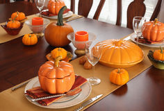 Table setting for Thanksgiving Day. With pumpkins Royalty Free Stock Photo
